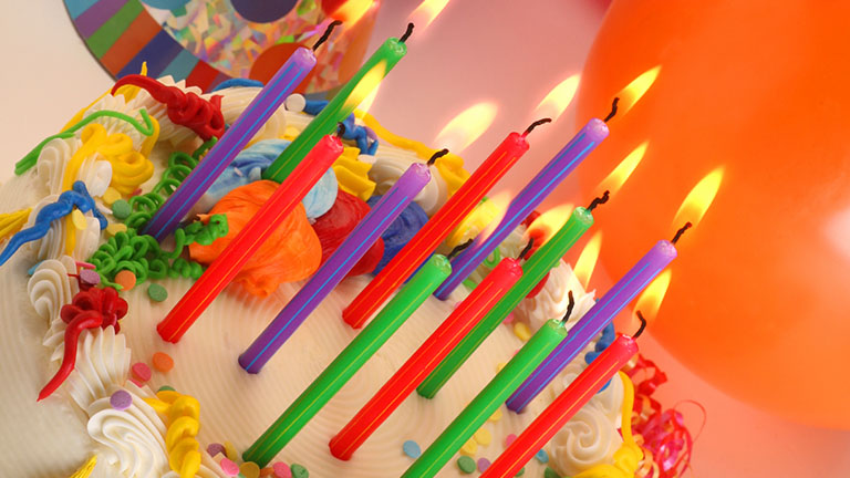 A birthday cake with candles.