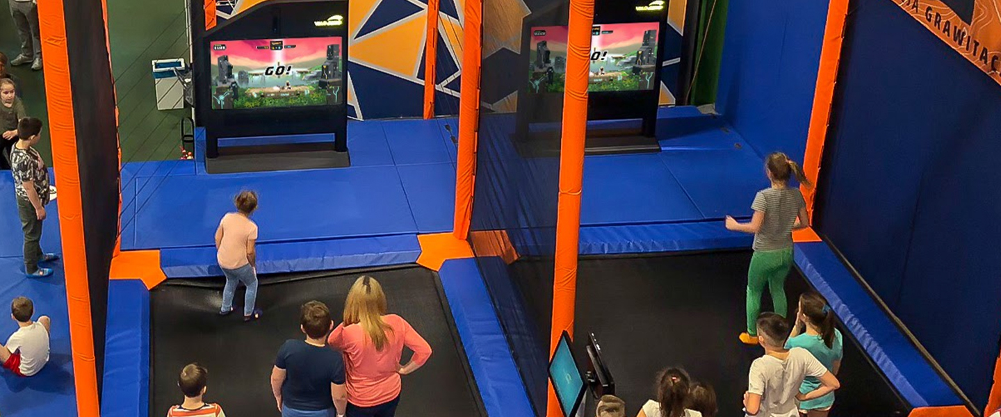 Kids jumping on trampolines inside Tom Foolerys Adventure Park.